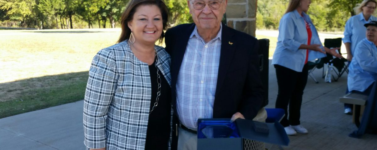 "Tammy Johnson (L), with Col. William W. ""Bill"" Lindsay, USMC Ret. after presenting him with the award."