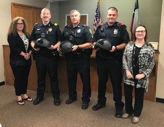 Pictured left to right presenting and receiving the helmets: Stephanie Davidson, Sgt. Cory Brookshire, Cpl. Jim Lewis, Ptl. Jeremy Hollar, and C.J. Durbin-Higgins.