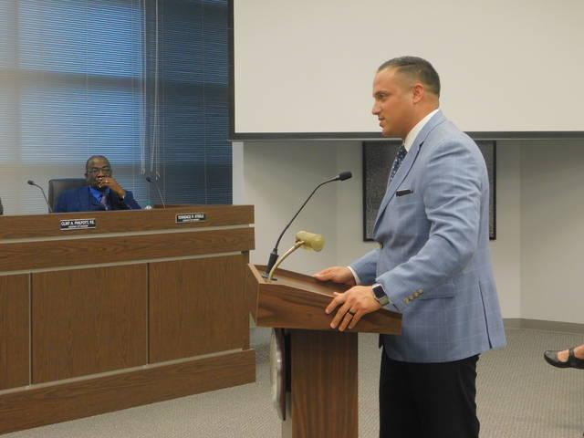 Sherman Police Chief Zachary Flores speaks before the Sherman City Council Monday night. The department is seeking to purchase a armored vehicle for the department using drug seizure funds. Photo copyright Herald Democrat / Michael Hutchins