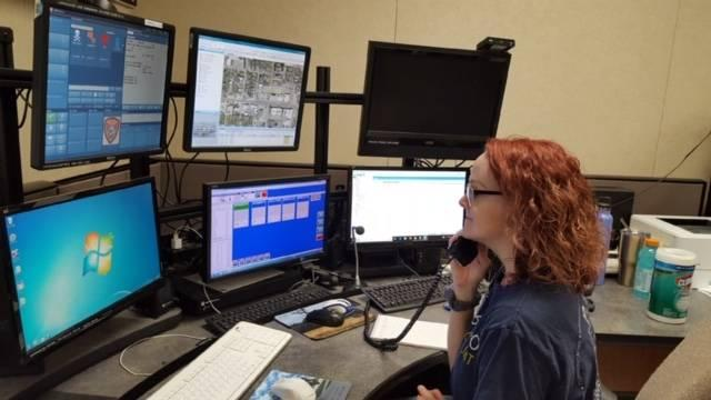 Whitesboro Police Department Public Safety Answering Point dispatcher Curlen Barger working on the existing 911 equipment that will be upgraded in the near future all across Grayson, Cooke, and Fannin counties