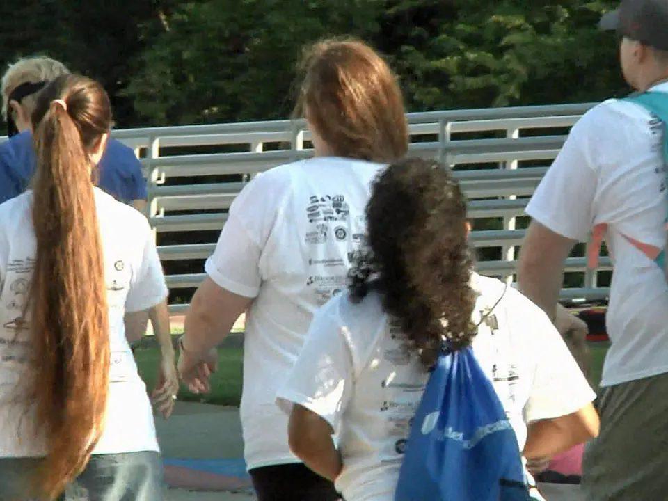 Participants in the Texoma Caregiver Celebration Walk at Grayson College. (KTEN)