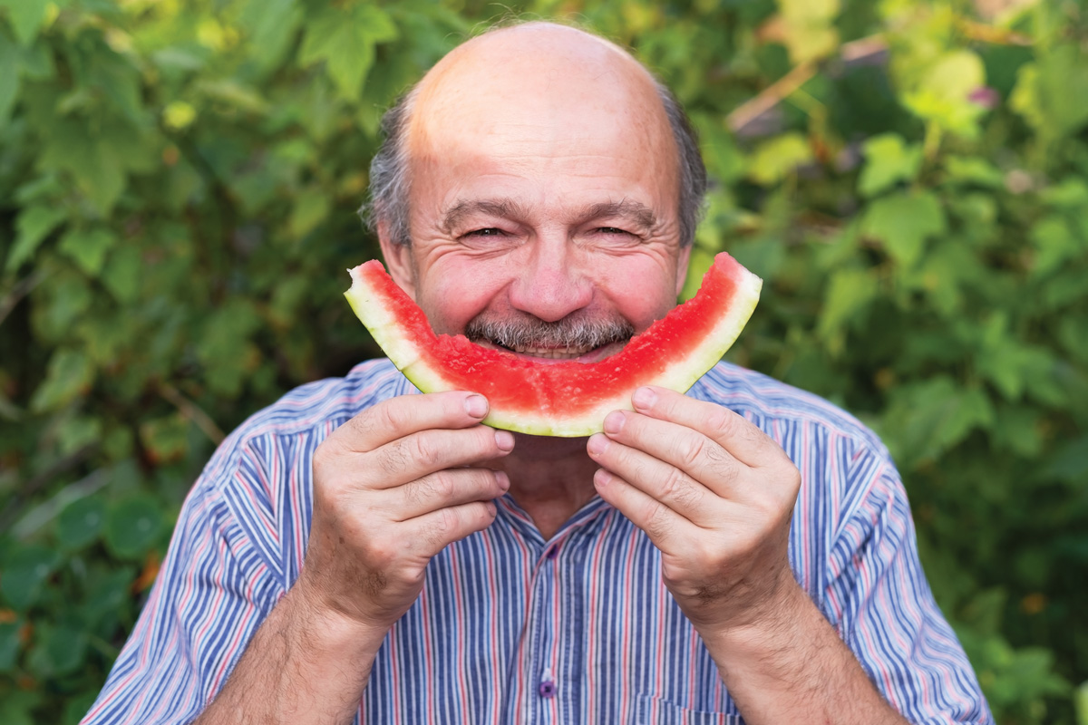 man-smiling-with-watermelon